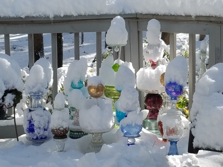 Glass totems buried in snow