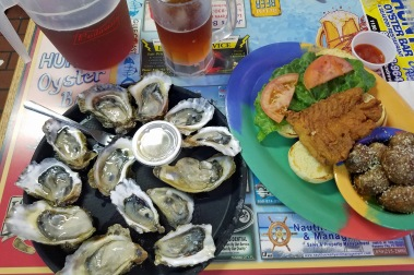 A plate of oysters and a grouper sandwich at Hunts.